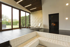 Futuristic living room with fireplace Stock Photos