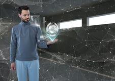 Futuristic man in a futuristic room interface the world. Stock Images