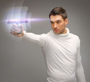 Futuristic man with gadget stock images