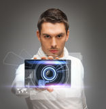 Futuristic man with gadget Royalty Free Stock Image