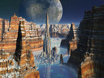 Futuristic Metropolis in Alien Canyon Valley. Soaring Rock Tower surrounded by futuristic alien city - set within enormous cliff formations - seen from above Stock Image