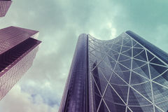 Futuristic, modern office buildings looking up Stock Images