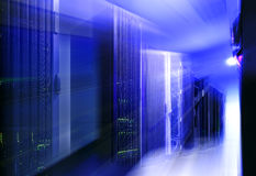 Futuristic modern server room in data center with light blur and motion Royalty Free Stock Image