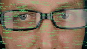 Futuristic monitor on face with code and information hologram. Eye hud animation. Future concept. Man face in glasses. Futuristic monitor on face with code and stock video footage