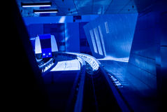 Futuristic Monorail Travel. Futuristic blue lighting and a passing tram in a tunnel highlight the future of monorail travel stock photo