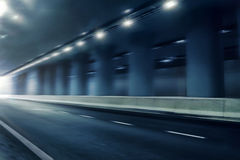 Futuristic motion blur road in tunnel Stock Images