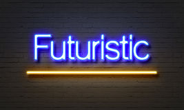 Futuristic neon sign on brick wall background. Royalty Free Stock Images