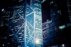 Futuristic night cityscape with illuminated skyscrapers. Hong Ko Stock Photography