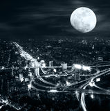 Futuristic night panorama of Bangkok skyline at full moon night. Stock Photography