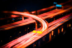 Futuristic night view of highway interchange. Bangkok, Thailand. Tilt shift blur effect. Abstract cityscape background. Futuristic night aerial view of highway Royalty Free Stock Photo