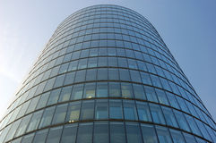 Futuristic office building facade. Oval futuristic office building facade Stock Images