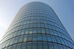Futuristic office building facade. Oval futuristic office building facade stock images
