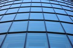 Futuristic office building facade. Oval futuristic office building facade royalty free stock images