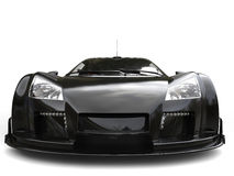 Futuristic pitch black supercar - front view extreme closeup shot. Isolated on white background Stock Image