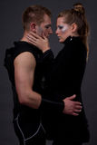 Futuristic Romance. Couple posing in futuristic outfits Royalty Free Stock Photography
