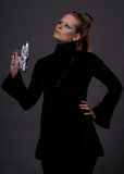Futuristic Romance. Female model posing in futuristic clothes with a weapon Royalty Free Stock Images