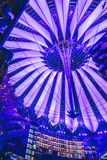 Futuristic roof of Sony Center. Berlin, Germany - January 13, 2018: Futuristic roof of Sony Center in Berlin illuminated at night Stock Image