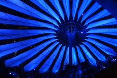 Futuristic roof of Sony Center in Berlin illuminated at night. Futuristic roof of the Sony Center in Berlin illuminated at night Royalty Free Stock Photos