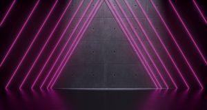 Futuristic Sci-Fi Room With Purple Neon Triangle Lights And Conc. Futuristic Sci-Fi Room With Purple Neon Lights And Concrete Wall With Empty Space And Royalty Free Stock Photo