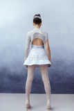 Futuristic young asian woman in full lenght. Back view. stock photos