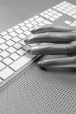 Futuristic silver gray hand and keyboard Royalty Free Stock Images