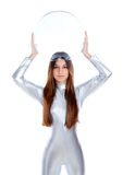 Futuristic silver woman holding glass helmet. Brunette futuristic silver woman holding sphere glass helmet Royalty Free Stock Photos