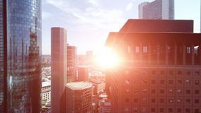 Futuristic skyscrapers at sunset sky. Aerial view of modern skyscraper buildings at sunset magic hour stock footage