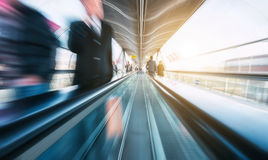 Futuristic skywalk with blurred business people Stock Photos