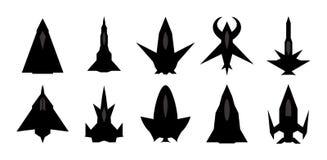 Futuristic spaceship silhouettes set. Stock Photos