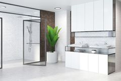 White cabinets bathroom, sink and glass doors side. Futuristic style bathroom interior with a white floor, brick walls and a shower. 3d rendering mock up royalty free illustration