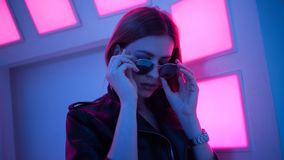Futuristic style portrait in blue and purple light. royalty free stock photography