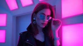 Futuristic style portrait in blue and purple light. stock photo