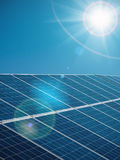 Futuristic sunny background of solar power plant with sun and blue sky Royalty Free Stock Photos