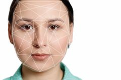 Futuristic and technological scanning of the face of a beautiful woman for facial recognition and scanned person. It can serve to royalty free stock images