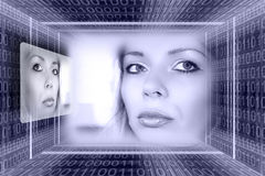 Futuristic technologies concep. T. Luminous girl in the binary code tunnel Stock Image