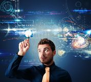 Futuristic touch screen interface. Businessman working with a futuristic touch screen interface Royalty Free Stock Photography