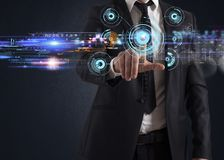 Futuristic touch screen interface. Businessman working with a futuristic touch screen interface Royalty Free Stock Image