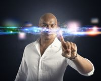 Futuristic touch screen interface. Businessman working with a futuristic touch screen interface Stock Image