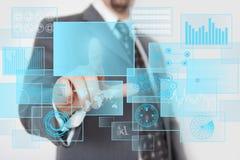 Futuristic touchscreen. Man pressing digital button in a futuristic touchscreen monitor Stock Photography