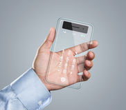 Futuristic transparent smart phone in hand Stock Images