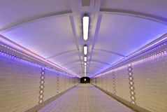 Futuristic tunnel. People walking in a futuristic tunnel Stock Images