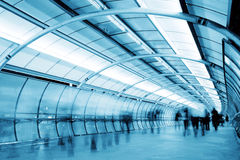 Futuristic tunnel. Business People walking in a futuristic tunnel. Shot with slow shutter speed to create blur effect Royalty Free Stock Photography