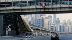 A futuristic urban landscape with a pedestrian crossing going over the highway in Dubai, United Arab Emirates. The landscape displays the traits of a modern stock video footage