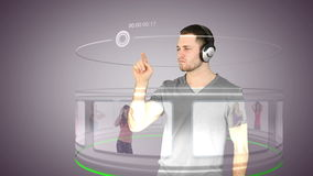Futuristic video of a man choosing music Royalty Free Stock Photography
