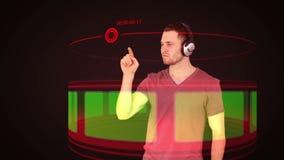 Futuristic video of a man choosing music on chroma key screen stock video footage