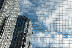 Futuristic view of glassy skyscraper walls reflected in each oth Royalty Free Stock Image