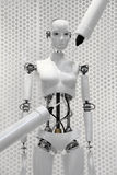 Futuristic white robot woman being made by the machines. Futuristic white cyborg robot woman being made by the machines royalty free stock photo