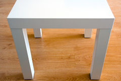 Futuristic white table on the floor Royalty Free Stock Images
