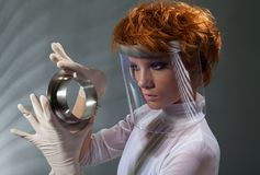 Futuristic woman examine metal detail Stock Photos