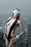 Futuristic woman in night city Royalty Free Stock Photography